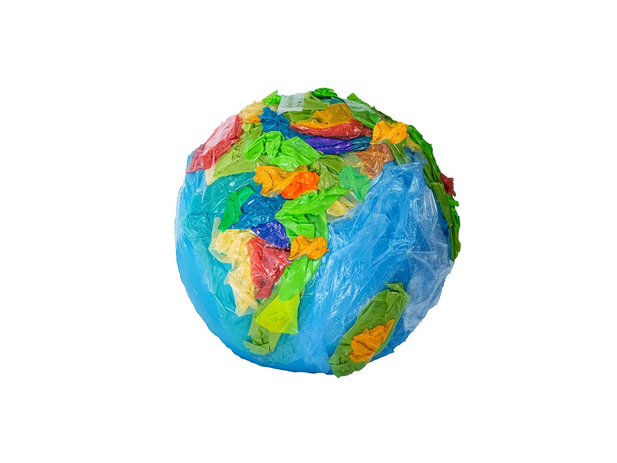 A depiction of the earth made from various plastics